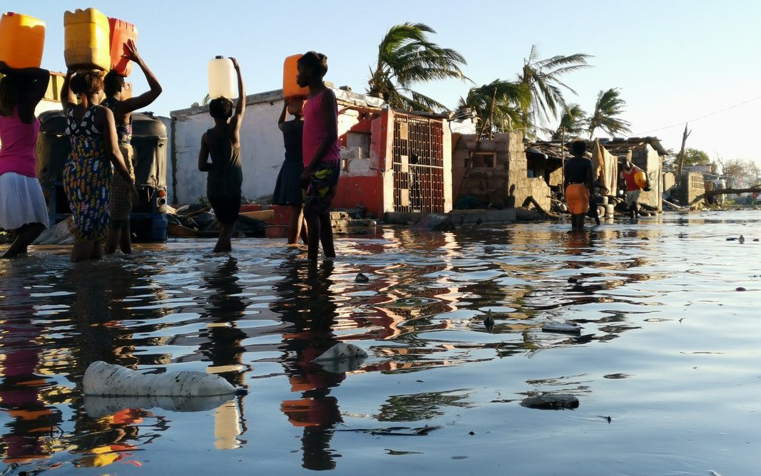 Cyclone survivors wading in flod waters in Beira Mozambique