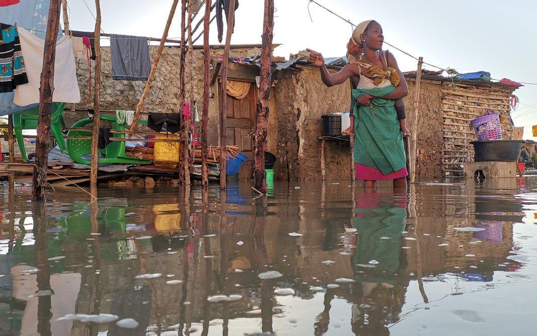 Flood survivor wading in water in Beira