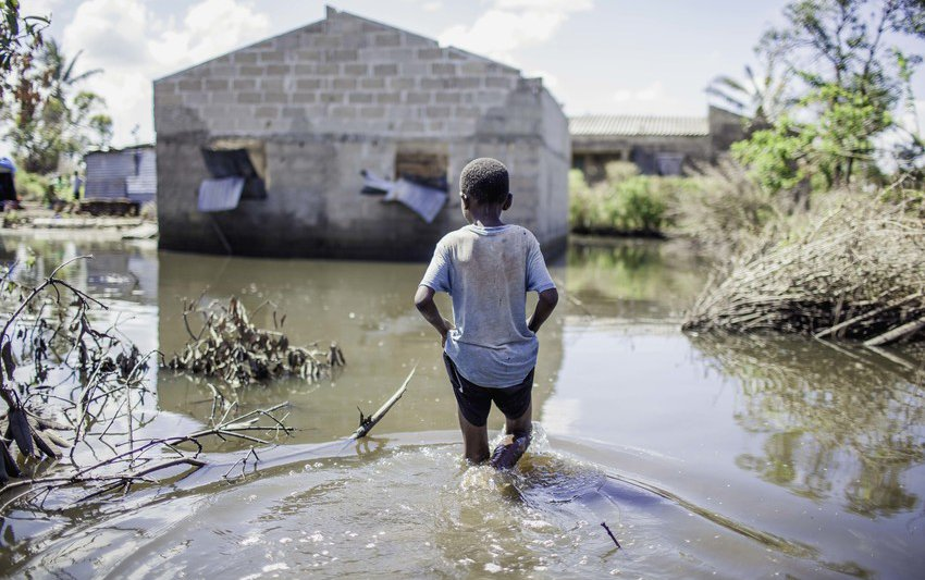 Wading through contaminated waters inside Tica village