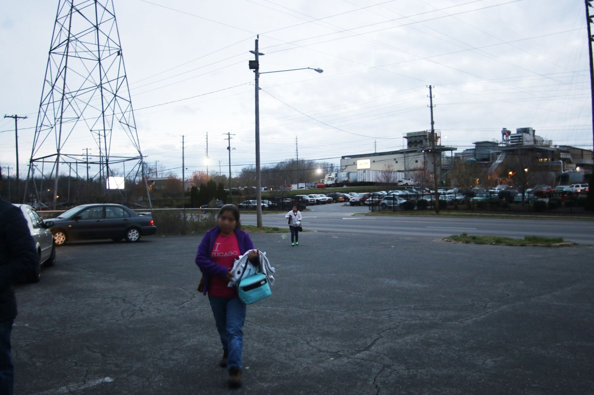 Evelyn (pseudonym) walks to work at a poultry plant in Morgantown, North Carolina.