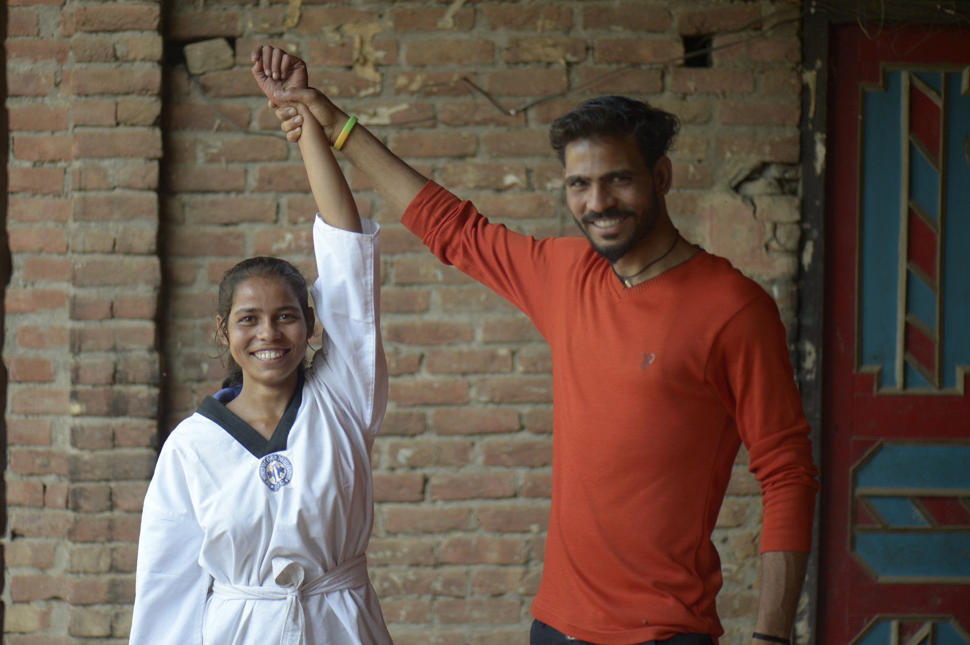 Amit Kumar works 14 hours a day to pay for his sister Dolly's schooling and support her martial-arts competition fees.