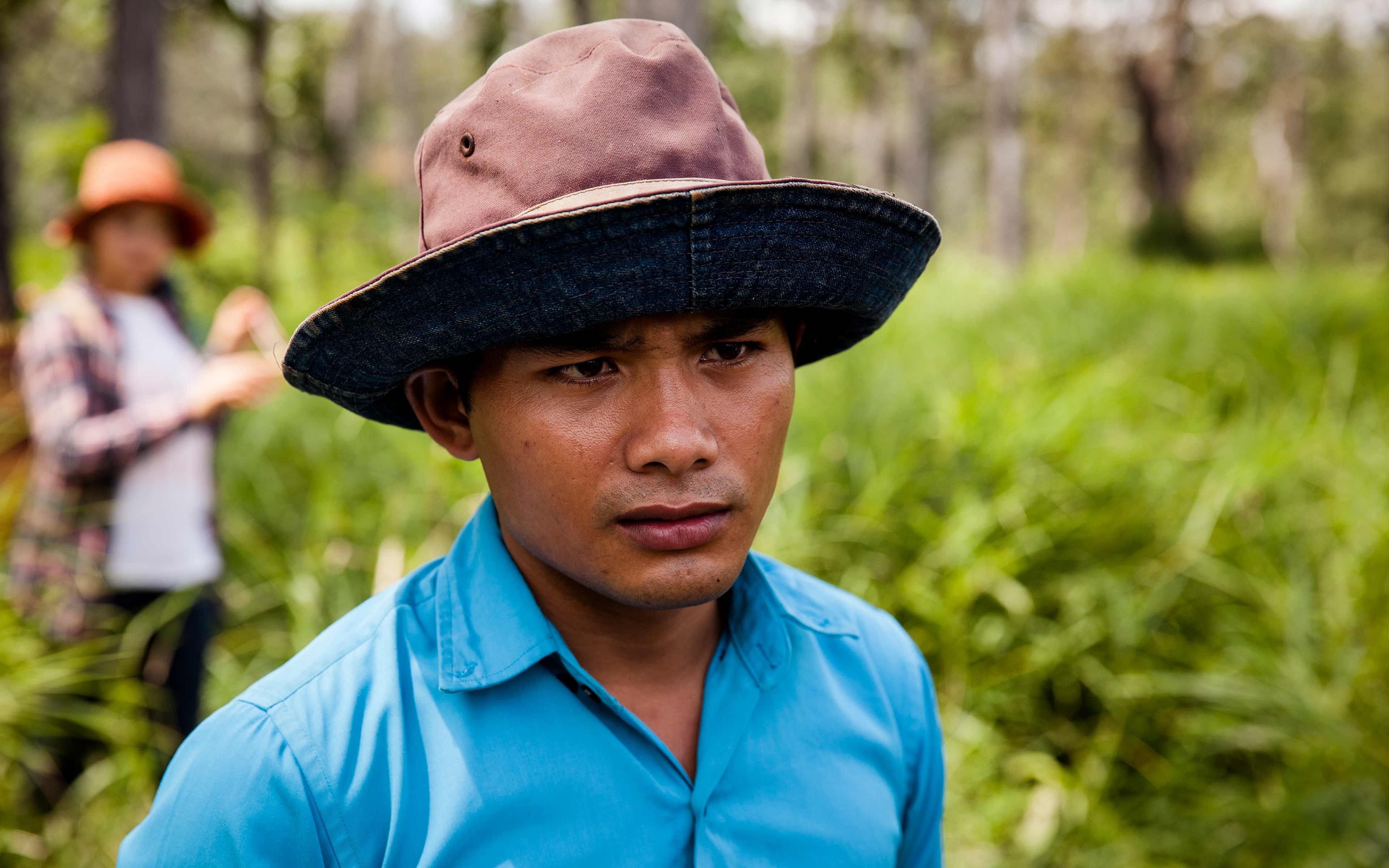 """Romam Nuth, 23, is a community journalist trained by Oxfam's partner Media One. He has become a leader of efforts to protect the forest in his village in northeastern Cambodia, and uses social media channels like Facebook to share information about his ethnic Jarai community and the community's struggle to protect its land and forest. """"Facebook is a useful thing,"""" he says. """"Without it, I could not share these issues with outsiders."""""""