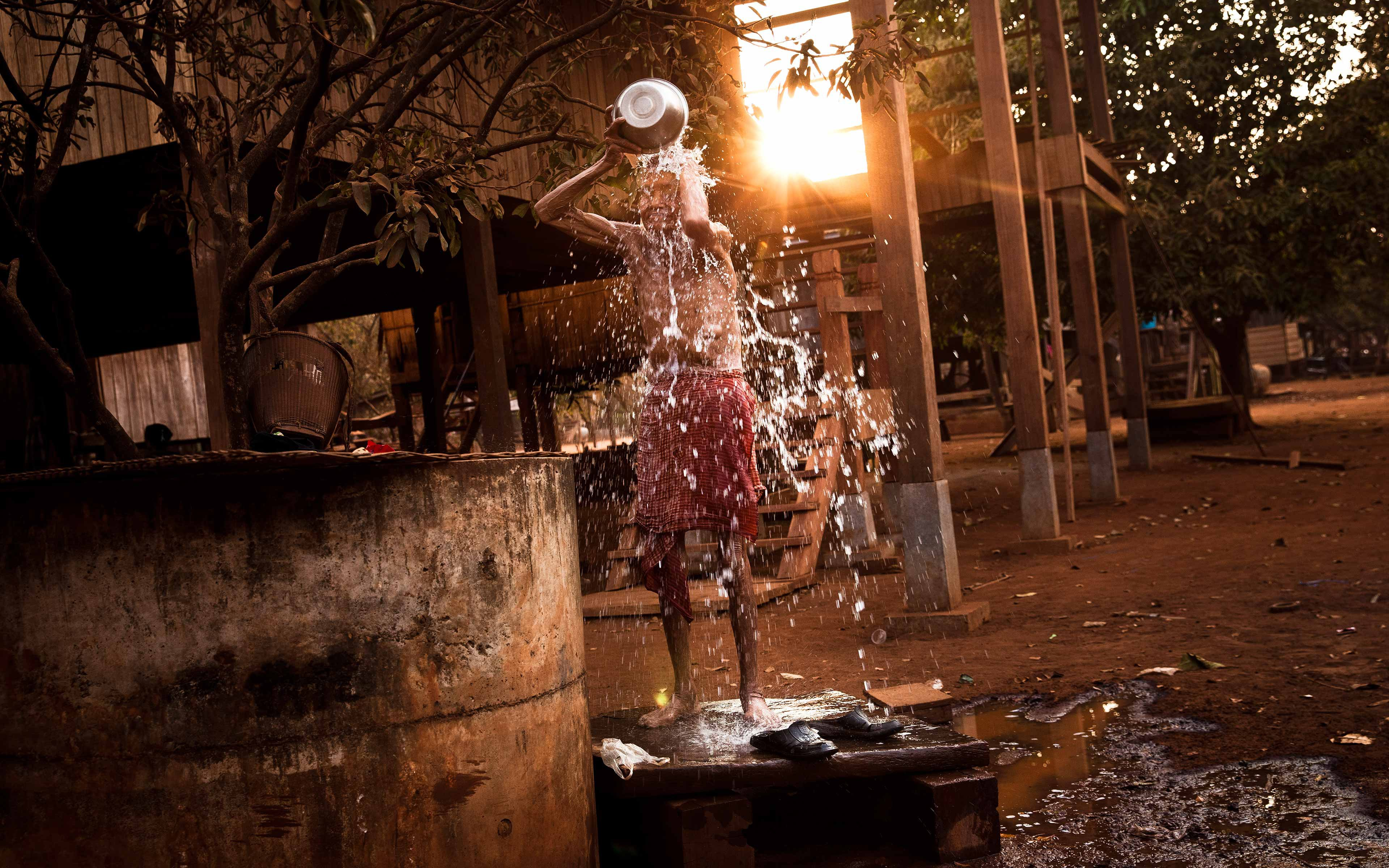 An elderly man bathes at the village well in Kanat Thom. Indigenous people in Cambodia are some of the most impoverished in the country. Though they consider their forest lands sacred, their government and foreign investors see only the money that can be made from those lands.