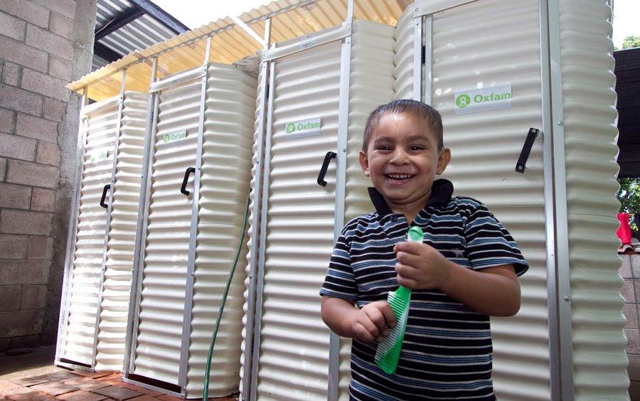 el-salvador-boy-with-latrines-oct2011.jpg