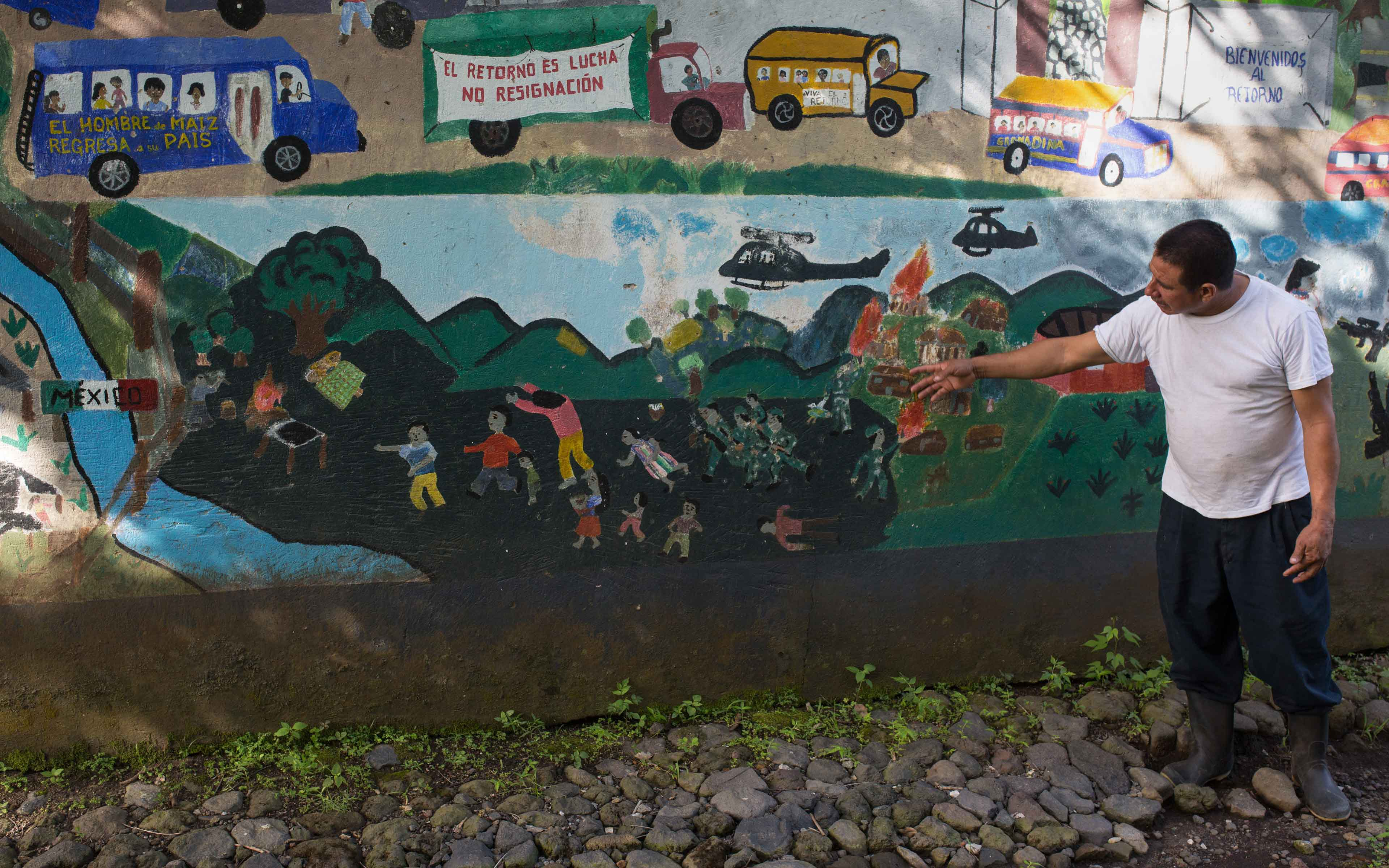 Gilberto Camposeco walks explains the history of his community, now known as La Trinidad, and how they had to flee the army to Mexico during the war in 1982