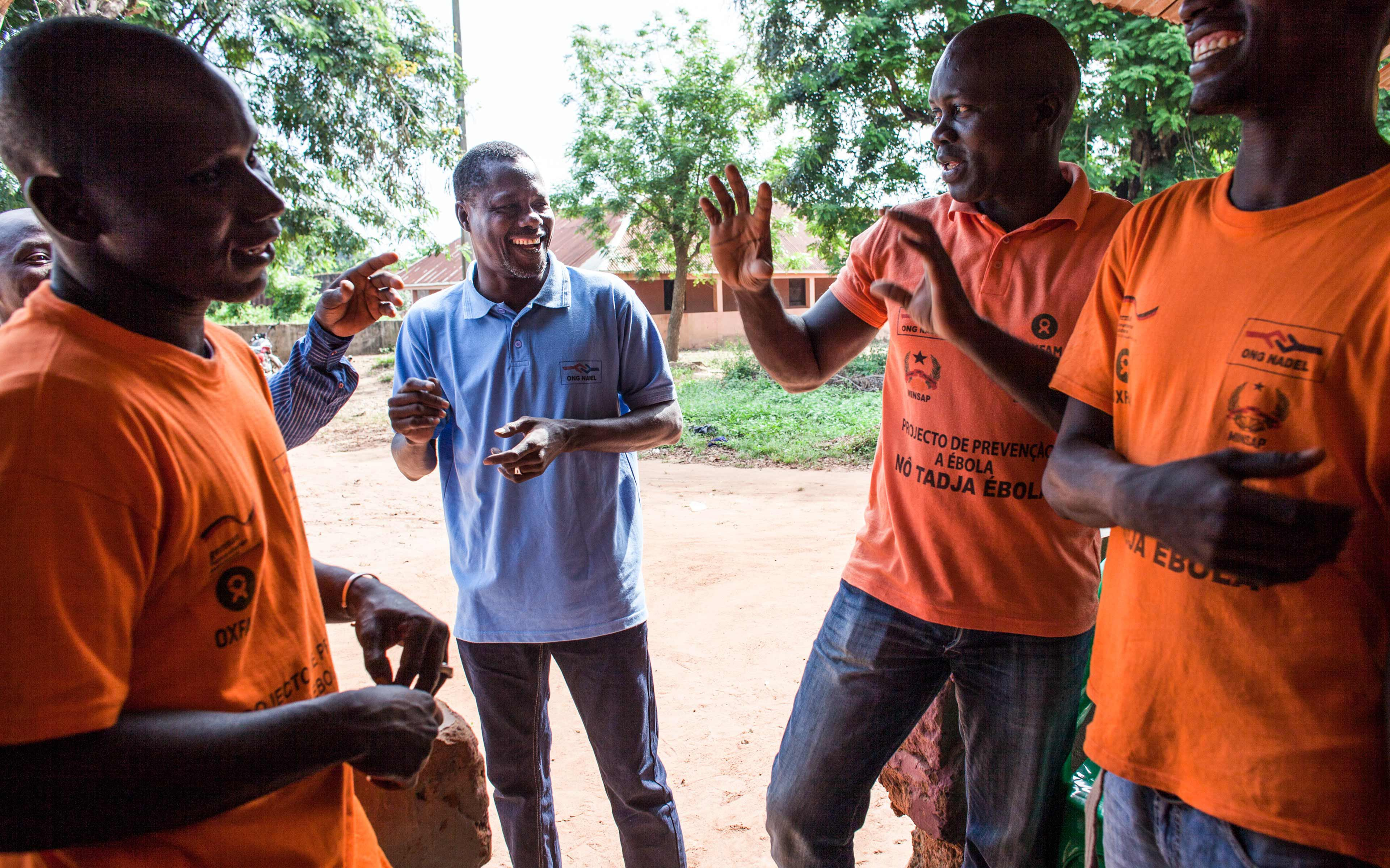 Sidi Jaquité talks with members of his Ebola rapid-response team in Catio, Guinea-Bissau. During the epidemic, the team deployed to communities that were slow to recognize the urgent need for Ebola preparedness measures—living in tents until they were satisfied the job was done.