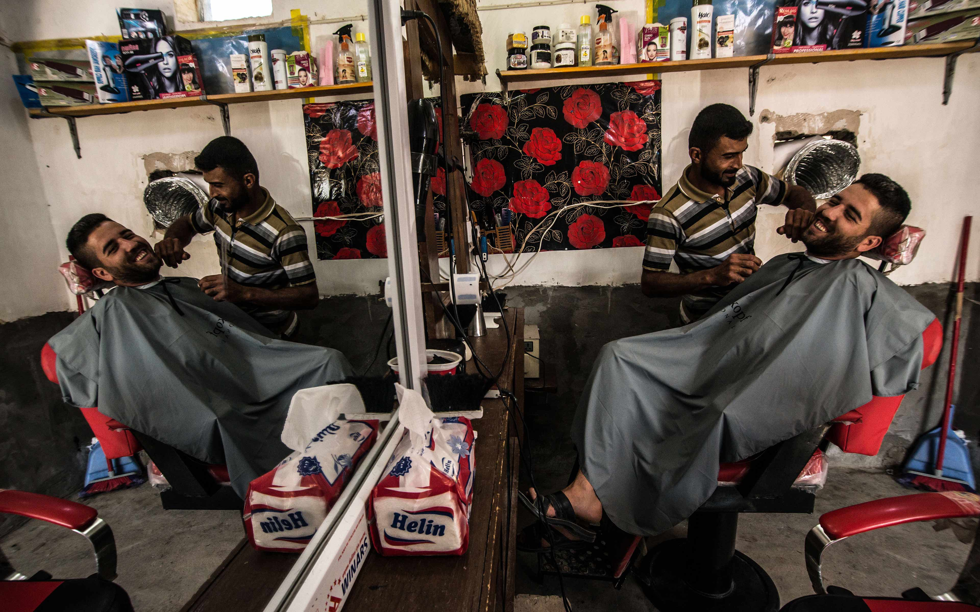 Qassim Daoud, whose name has been changed for his protection, was able to restart his barber shop with help from Oxfam. The shop was looted by ISIS in 2014 when it took over the village. The community has now been reclaimed and Daoud is happily back at work.