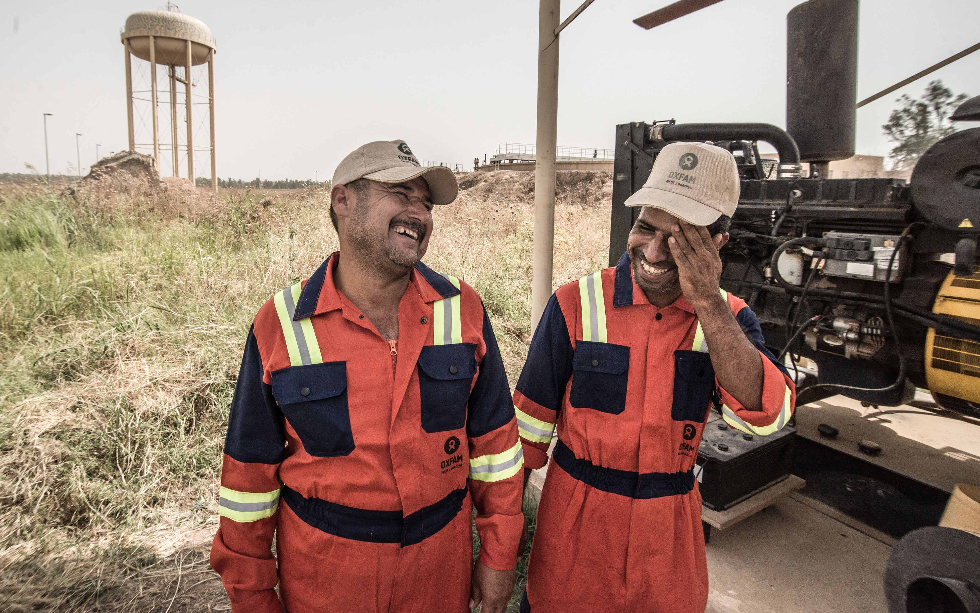 Two staffers from the local water plant in the Iraqi community of Saadiya share a laugh. They were among the first to return after the town as reclaimed following an ISIS occupation.