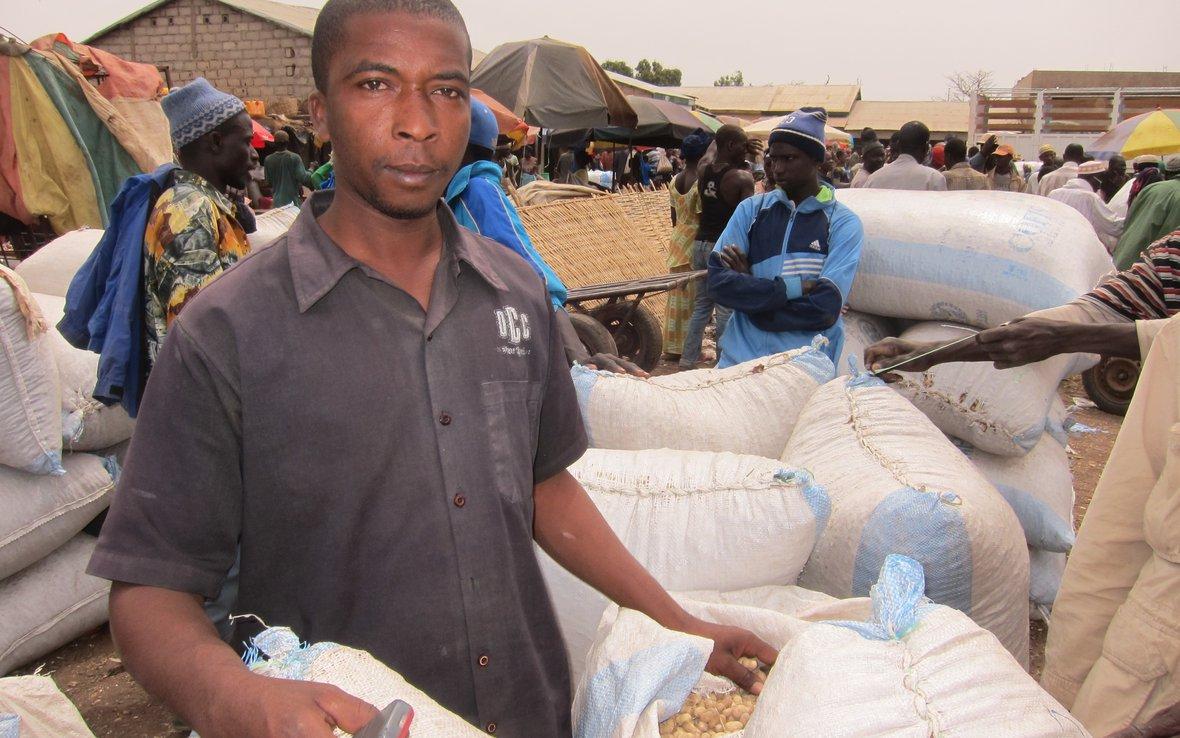 man-in-kolda-with-sacks-of-grain-senegal-march-8-2012