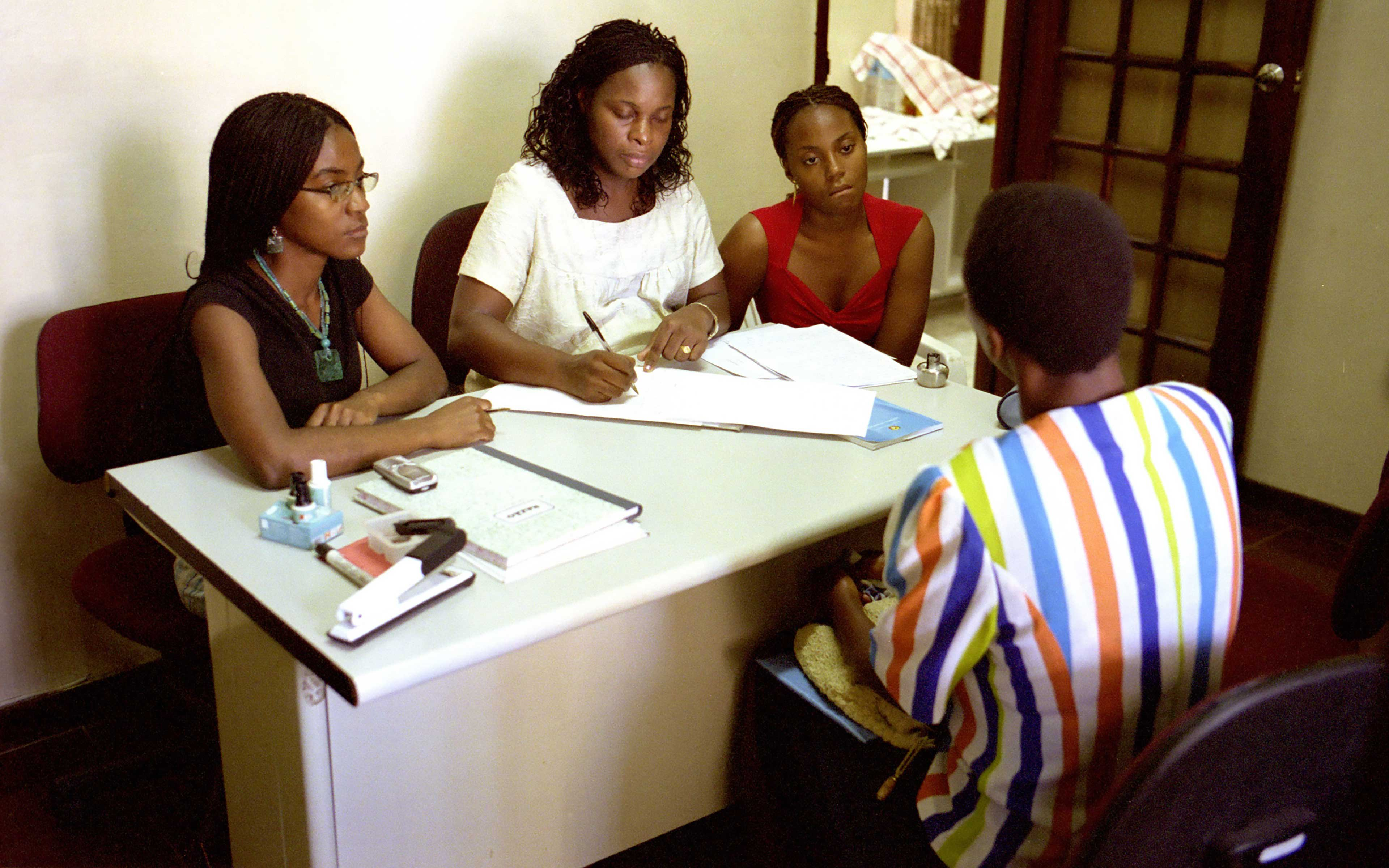Attorneys at the Mozambique Women's Lawyer Association advise a client in their Maputo office. The association was a key member of the coalition Oxfam worked with that researched and proposed the Family Law.