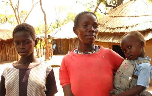 south-sudan-woman-in-red-holding-child.jpg