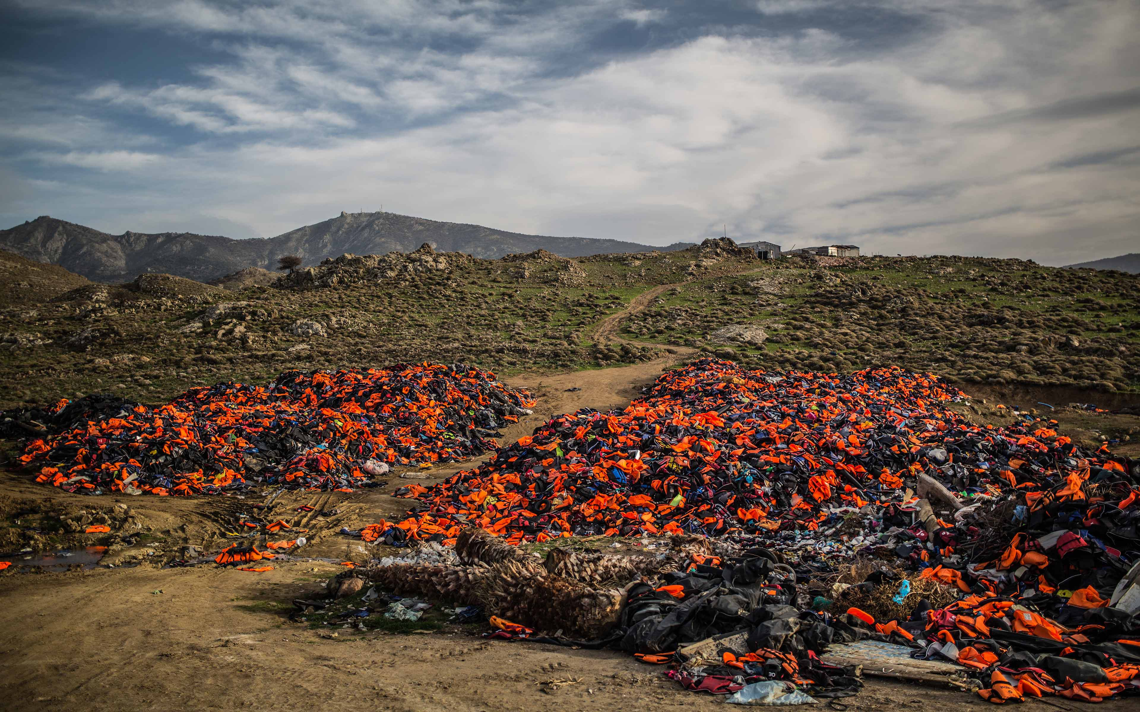 A small mountain of lifejackets lie on the Greek island of Lesbos. In February, 2016, as many as 50 boats a day crowded with refugees were landing on the shores here.