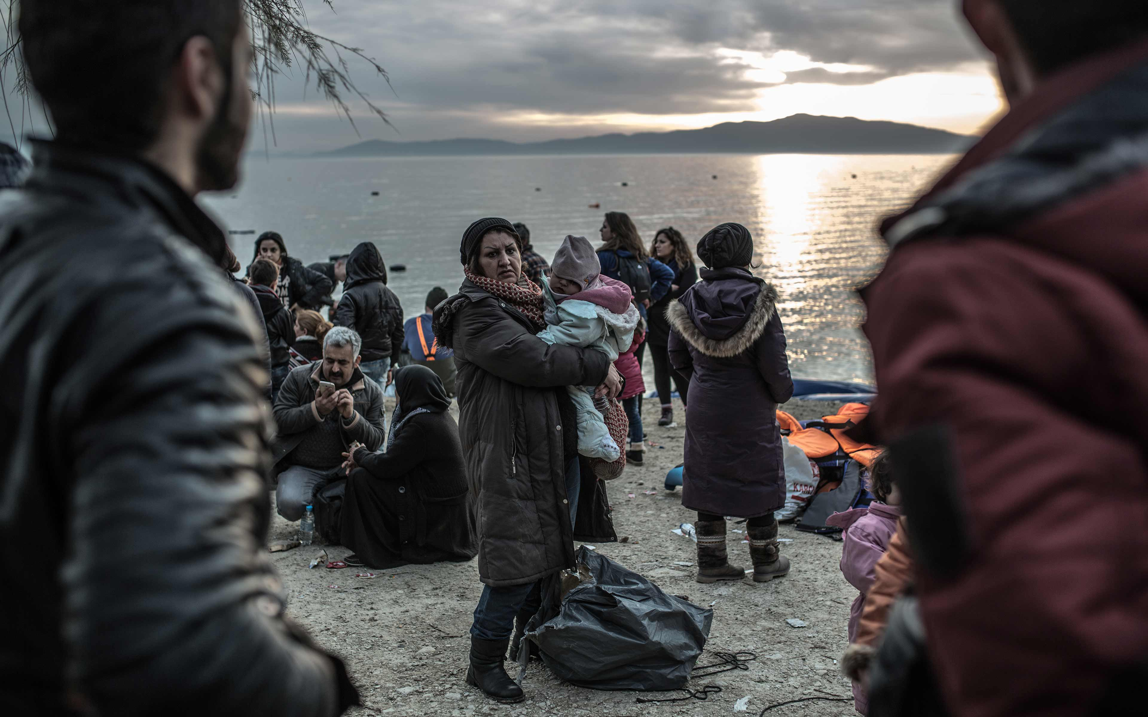 Safe on shore, refugees who made it to the Greek island of Lesbos in February 2016 plan for the next step of their long trek to safety. Already many have endured a harrowing journey, paying traffickers up to 1,000 Euros per person for the passage.