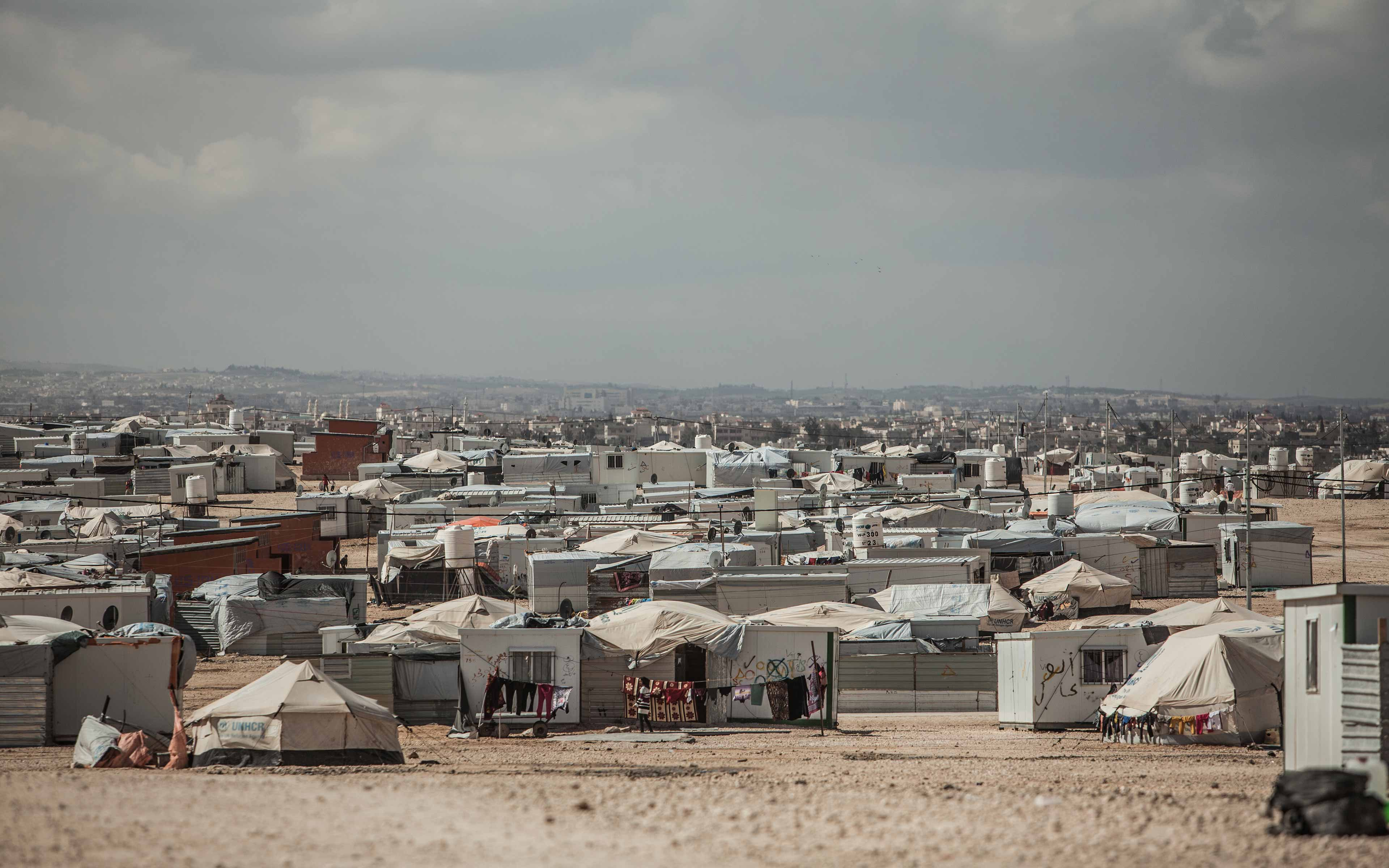 """The Zaatari refugee camp in Jordan is now sheltering tens of thousands of people from Syria, making it the fourth largest """"city"""" in the country.  It is a kind of no man's land, says photographer Pablo Tosco. A place of """"limbo where people are trying to process the traumatic experience of war."""""""