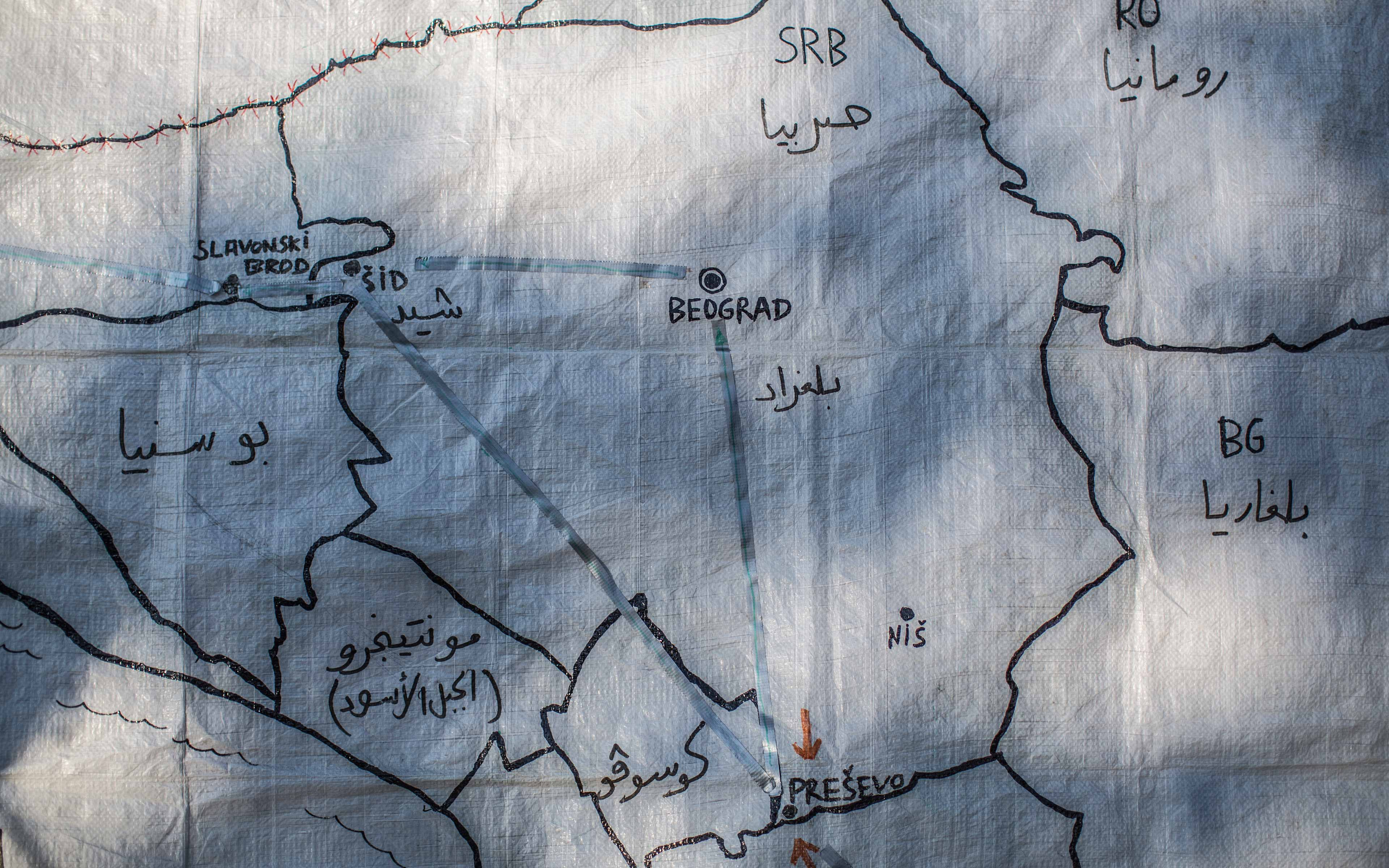 """A map drawn on a piece of plastic sheeting marks key points in Serbia— Presevo and Sid-- for refugees making their way toward safety. """"There is a common feeling in Zaatari, in Lebanon, in Turkey, or in the Balkans route and it is that there is no Syria where they (refugees) can go back to,"""" says photographer Pablo Tosco."""