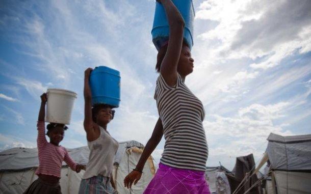 woman-carrying-water-haiti-ogb-62211_610x381.jpg