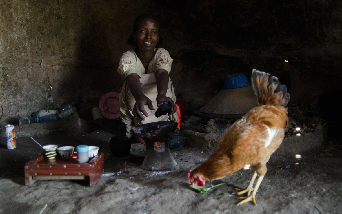 woman-home-chicken-ethiopia-ous-48794.jpg