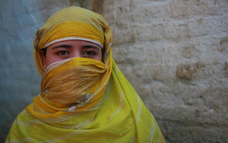woman in yellow shawl
